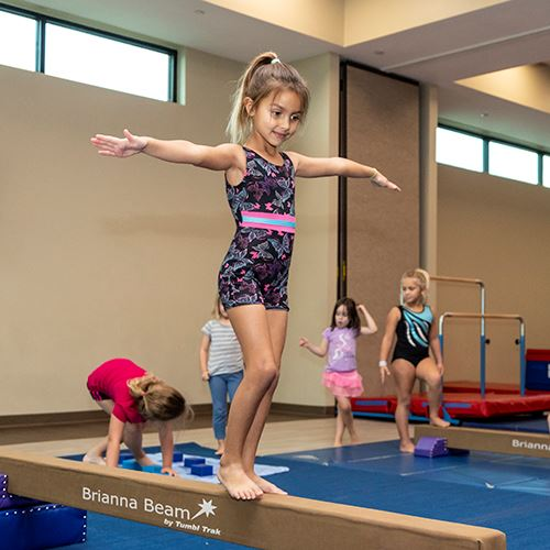Young Girl Walking on Balance Beam