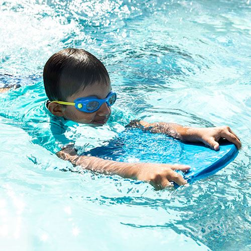 Boy Swimming With Kickboard