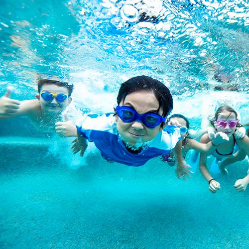 Kids Swimming Underwater