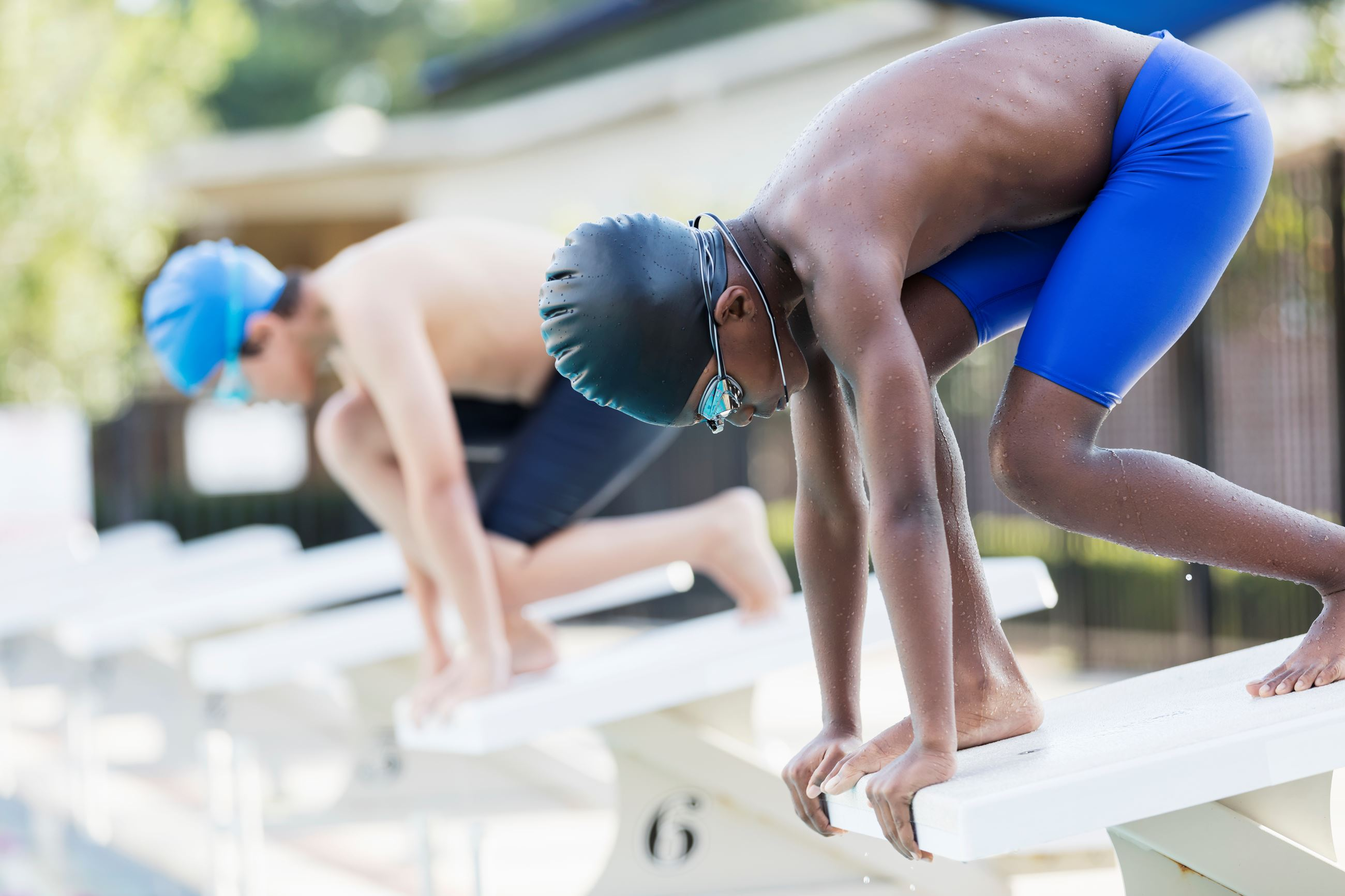 Young Swimmers on Starting Blocks