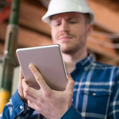 Contractor Using a Tablet on a Jobsite