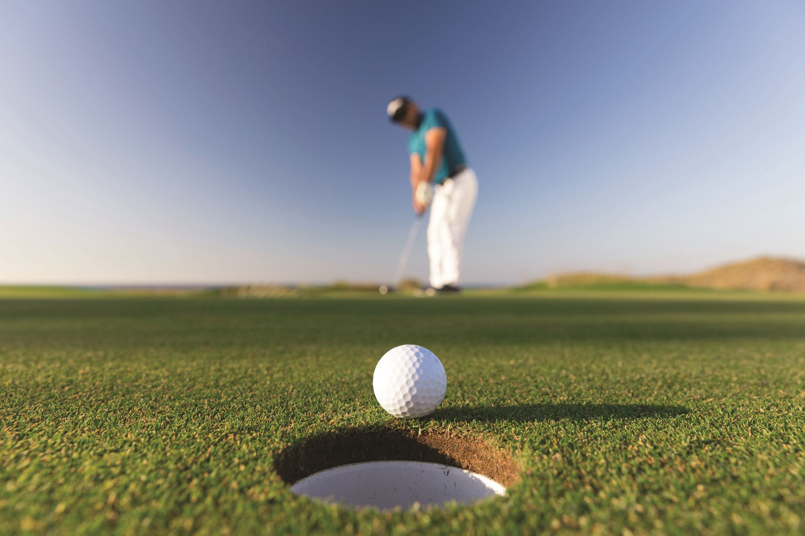 Golfer Making a Putt